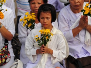 A girl making offerings at Ajahn Chah's Memorial Celebration