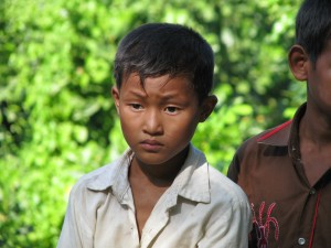 Young Chittagong boy at an alms giving ceremony