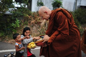 Child Offering Bananas to Ajahn Viradhammo