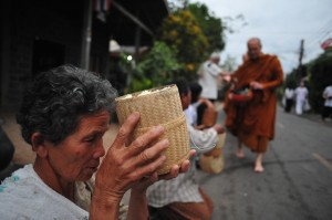 Woman Offering Sticky Rice in Ubon Rajathani